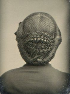 Woman Seen from the Back (Ca 1865) Gorgeous look at the dressed hair under a fine net.