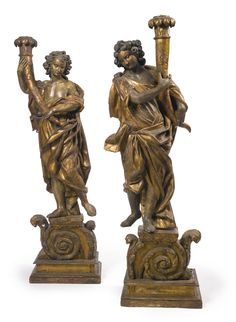 A pair of Italian Baroque polychrome-painted and carved giltwood torchères second half 17th century