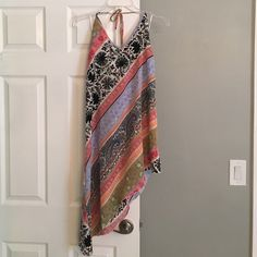 O'neill asymmetrical dress Brand new with tags sundress. It slants down the side. Halter style top O'Neill Dresses Asymmetrical