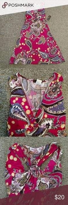 NWT: Pink multicolored boho design mini dress New with tags!! Pink multicolored boho design. Super soft material. Lightly padded deep v-neck in front. T design straps in the back. Perfect for a night out. Size large but could fit a medium. By M. M Dresses Mini
