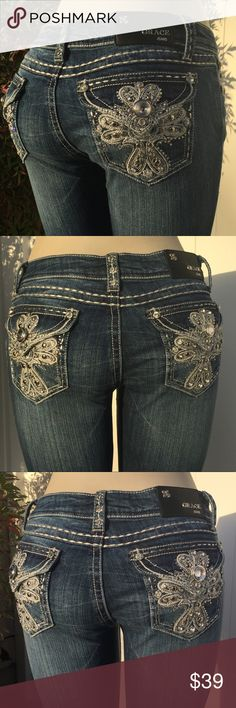 """NEW Grace In LA Rhinestone Bootcut Jeans Size 15 NWT Grace In LA Angels Bling Bootcut jeans Style #5446 Size 15  Perfect Jeans w/ 5 pocket design, zip fly and a button waistband.  Beautiful rhinestone embellished front and back pockets.  Dark Blue Wash in color with white stitching  Measurements:  Waist 35""""  Front Rise 9.5""""  Inseam 33""""  96% Cotton / 4% Spandex   RETURNS AND EXCHANGES  Pls ask any questions prior to buying this item as all sales are final! No returns or exchanges Grace Jeans…"""
