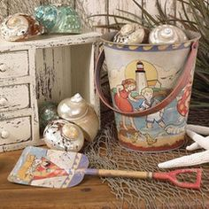 """This metal sand pail and matching shovel is a reproduction of the vintage beach toys"" ~ (http://www.beachgrassshop.com/collections/decor/products/vintage-sand-pail-and-shovel)"