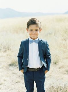 Navy suit and adorable bowtie: http://www.stylemepretty.com/little-black-book-blog/2017/01/02/rustic-elegant-montana-ranch-wedding/ Photography: Simply Sarah - http://simplysarah.me/