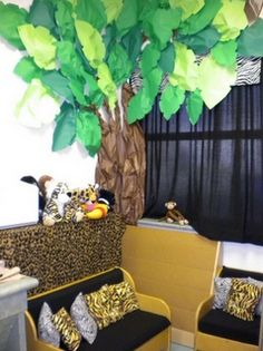 Safari Theme for classroom reading corner. Animal print pillows would be cute in my reading corner.