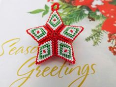 Christmas 3D Peyote Star Ornament Beaded Red Green White Seed Bead by MadeByKatarina on Etsy https://www.etsy.com/listing/240382481/christmas-3d-peyote-star-ornament-beaded