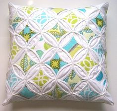 """I fell in love with this pillow cover with cathedral windows by warmnfuzzies  -  Do you notice how one printed fabric can have produce many different """"window panes"""" from it?"""
