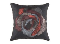 Cushion that might go well with the red armchair