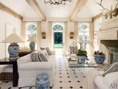 blue and white and beams - What could be better than that?  Maybe a rug on the floor to soften the landscape.