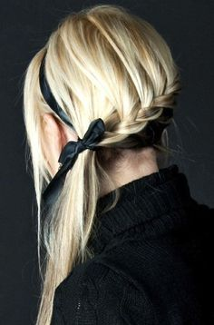 So simple and yet so beautiful! Lower french braid, using a ribbon as a headband and also to tie into a bow around the end of the braid.