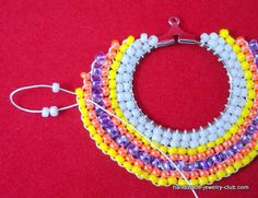 Make bold and bright adornments for your ears with this DIY jewelry making tutorial. Learn how to make earrings that are stylish and standout with this Colorful Circular Brick Stitch Earrings pattern.