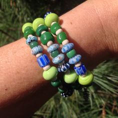 One size bracelet. M-L Green & blue coiled bead by PlusPerfect4U