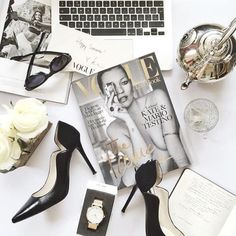 Photo styling - black & white flat lay with laptop, heels and Vogue