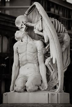 The kiss of death. This astonishing sculpture forms part of. (The Messes of Men) * The kiss of death ~ This astonishing sculpture forms part of Barcelona's Poblenou Cemetery. The Kiss of Death (El Petó de la Mort in Catalan and El beso de la muerte in S La Danse Macabre, Illusion Kunst, Kiss Of Death, Angel Of Death Tattoo, The Death, Cemetery Art, Cemetery Statues, Angel Statues, Arte Horror