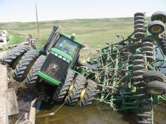 Tractor Accident.Looks like a John Deere 9400 with triples