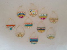Unusual wire and bead earrings - great patterns, remind me of easter eggs.