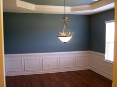 SW6221 Moody Blue by Sherwin Williams for a beautiful dining room wall color.