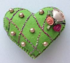 Pincushion, green heart.