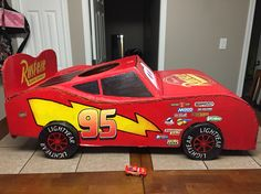 Costume lightening mcqueen More logos and its done Lightening mcqueen costume Cars Theme Cake, Car Themes, Cars Birthday Parties, 4th Birthday, Lightning Mcqueen Costume, Piñata Cars, Wagon Costume, Cars Junior, Lightening Mcqueen
