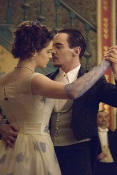 Jonathan Rhys Meyers and Jessica de Gouw dancing in the ballroom in Episode 5 of Dracula - sky.com/dracula