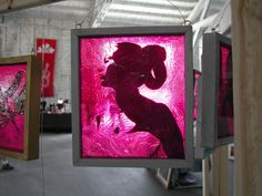 a translucent painting adhered to glass.