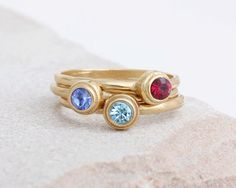 Mix and match! This set of three stackable birthstone dot rings is perfect for the grandmother or mother of three. Represent three special people in your life with these stylish stacking rings.  This listing is for a set of three 24K gold vermeil and Swarovski crystal birthstone rings. Each ring has only one stone.  This style stacks well with our Gold Initial Rings :: //www.etsy.com/listing/213597800/set-of-two-mothers-initial-rings-stacked?ref=shop_home_active_15…