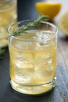 Bourbon Sour with Lemon & Rosemary: 1 1/2 ounces bourbon 1 ounce fresh lemon juice 3/4 ounce rosemary simple syrup