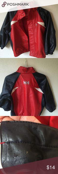 Helly Hansen rain jacket • toddler size 4 Helly Hansen rain jacket • toddler size 4 • has some flaws (gold spray paint) small spots on front and back see pics.  Larger gold paint inside front by snaps, which you don't see from outside • detachable hood •. Hood has small worn spot pic #3 • all snaps work • no tears Helly Hansen Jackets & Coats Raincoats