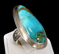 This handmade kingman turquoise ring is perfect for gift giving! QuirkyGirlz.com