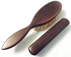 a pair of ebony mounted brushes
