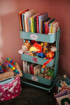 Great use of an IKEA cart - to store books, toys and stuffed animals in the nursery or kids room!