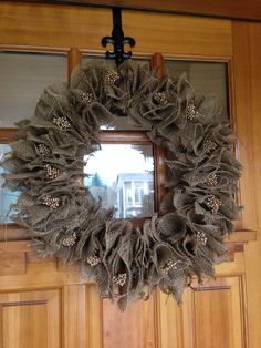 Burlap wreath. Made with a grapevine wreath so you can customize it for every season! I want to put baby's breath in it for spring and holly berries for Christmas! #burlap #burlapwreath #seasonal #diy #easydiy