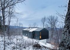 Gabled residence rests atop a rocky slope in Quebec