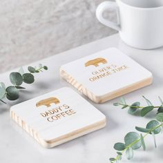 A set of two solid wooden coasters featuring a sweet daddy bear and baby bear. A super gift for dad this Father's Day. Each wooden coaster will be engraved with a sweet bear image. Choose to add dad'.