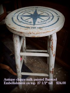 Antique bar stool painted in milk paint with embellishment on top