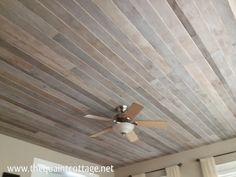 DIY:  How to Cover a Popcorn Ceiling With a Faux Rustic Plank Ceiling - using underlayment cut into planks and different colors of wood stain - via The Quaint Cottage