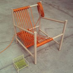 Using rope to incorporate textile techniques at a magnified scale, the Loom Chair, created by Laura Carwardine, combines the use of soft and hard materials frequently used in factory production. The seat and back support for this lounge chair are created from one continuous piece of orange rope, wrapped over a wooden dowel rod structure, as you would see in a traditional cloth loom. (5)