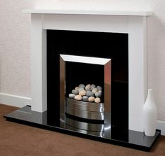 The Camden white fire surround shown with black granite hearth and back panel and inset pebble gas fire White Fire Surround, White Fireplace Surround, Wooden Fireplace, Fireplace Inserts, Fireplace Surrounds, Wooden Fire Surrounds, Granite Hearth, Fake Fire, Electric Fires