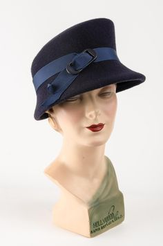 c1a59f2d40b This formed felt hat has a sloping crown which perfectly balances the asymmetric  brim. Fitted with a petersham ribbon on the inside for comfort and trimmed  ...