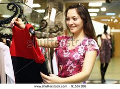 stock photo : Young woman doing shopping and choosing clothes