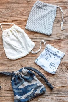 photo of 4 different drawstring pouches made form the sleeves of baby clothes