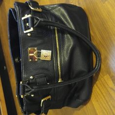 Black Anne Klein purse In great condition worn a few times for the past year. Gold accents Anne Klein Bags Shoulder Bags