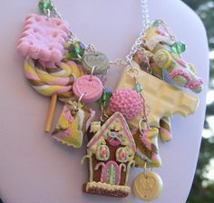 Christmas Gingerbread Necklace , Polymer Clay Charm House, Man, Chocolate, Candy Canes, Lollipop, Cookie, Crystals. £49.99, via Etsy.