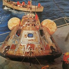 Apollo 11 Command Module Colombia being hoisted onto the deck of the aircraft carrier Hornet, 950 miles southwest of Hawaii.