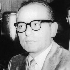 Santo Trafficante was born November 15, 1914 in Tampa Bay, Florida. He gained the majority of his position through the consolidation of power his father had done as the boss of Florida and Cuba. Santo was reportedly the most powerful mob boss in Batista era Cuba. During that time he operated multiple casinos, until Castro's revolution at which time his assets were confiscated and he was expelled from the country.