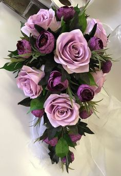 Most Attractive Elegant Purple Wedding Ideas---Purple roses bridal bouquets with greenery, spring weddings, outdoor wedding ideas, country weddings, elegant wedding flowers Ranunculus Bouquet, Rose Bridal Bouquet, Bridal Bouquets, Wedding Cake Fresh Flowers, Purple Wedding Bouquets, Lavender Roses, Purple Roses, Elegant Wedding, Floral Arrangements