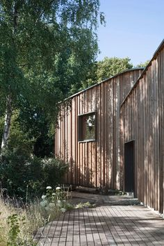 Image 16 of 24 from gallery of After-School Care Centre Waldorf School / MONO Architekten. Photograph by Gregor Schmidt Prefabricated Structures, Urban Island, After School Care, Wooden Facade, Woodland House, Susa, Industrial House, Outdoor Areas, Loire