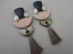Tribal Tassel Earring - Rose Rose, metallic black and white granite polymer clay with gold foil detail. Metallic gold and black stripe tassel. Surgical steel ear posts with stainless steel extra secure rubber ear nuts. Measuring approximately 110mm long x 35mm wide. Very