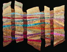 Each panel of this quilt was constructed and quilted separately and then it was joined together.  It is inspired by the many canyons I saw on a trip out west.