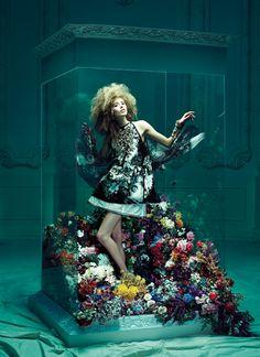 """A Fancifull Minidress Blossoms Amid a Garden of Petals"" from the editorial ""Fantasyland""   Model: Taryn Davidson, Photographer: Chris Nicholls, Flare, April 2010"