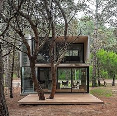 Luciano Kruk adds board-marked concrete holiday home to seaside resort near Buenos Aires This concrete summer house by Argentinian architect Luciano Kruk stands among pine trees in the seaside resort of Mar Azul near Buenos Aires. Interior Architecture, Interior And Exterior, Interior Design, Casas Containers, Concrete Houses, Seaside Resort, Cabins In The Woods, Tiny House, House Design